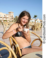 Girl with ice-cream at resort