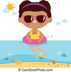 Girl with inflatable rubber ring swimming in the sea.