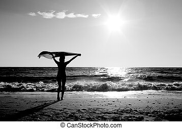 Girl with kerchief on beach