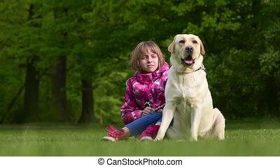 Girl with labrador retriever dog - Little girl with labrador...