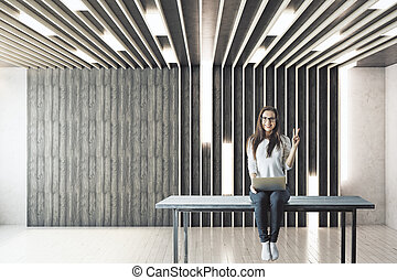 Girl with laptop in empty room