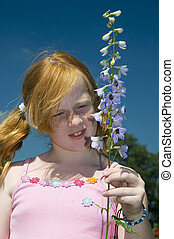 Girl with larkspur flower