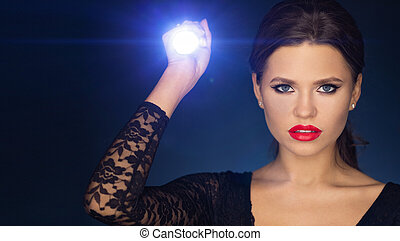 girl with led flashlight looking for something