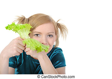 girl with lettuce in her hand.