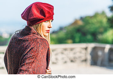 Girl with lipstick dressed in burgundy