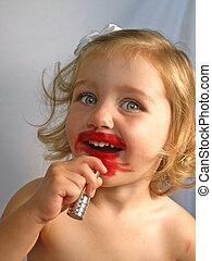 girl with lipstick - little girl applying lipstick