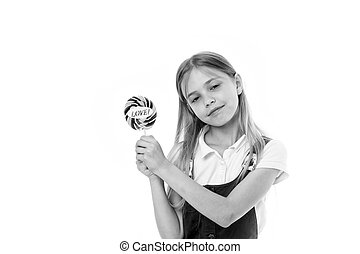 Girl with lollipop isolated on white. Little child hold candy with love lettering. Sweet beauty and look. Valentines day romance. Candyshop concept. Childhood and happiness. Sharing sweet love
