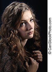 Girl with long curly hair.