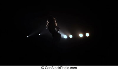 Girl with long hair dancing in the studio