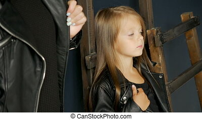 girl with long hair in black leather jacket