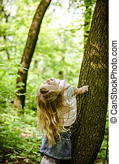 girl with long hair in forest