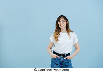 Girl with long hair in large glasses with diopters in a white T-shirt and jeans