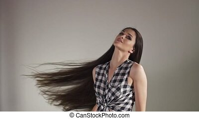 Girl with long hair posing - Brunette girl with long and...