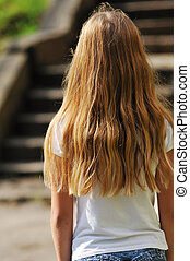 Girl with long hair rear view portrait