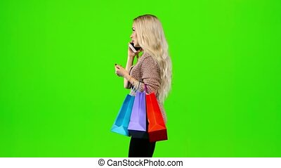 Girl with long hair shall be in the hands of multi colored packages. Green screen