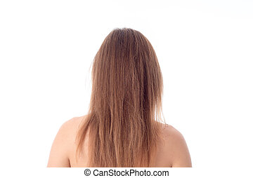 girl with long hair stands  his back to the camera isolated on white background
