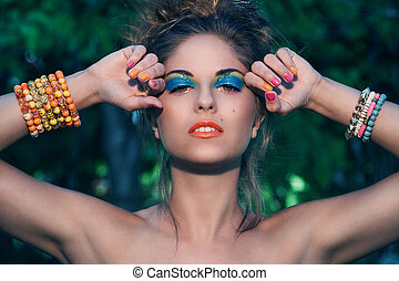 Girl with makeup and handmade bracelets