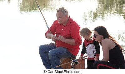 Girl with man fishing