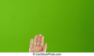 Girl with manicure waving Hello raising hand up. Green...