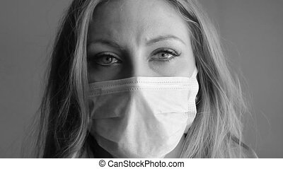 Girl with medical mask. BW.