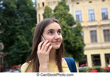 Girl with mobile phone in the city