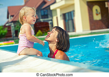 Girl with mother in the pool