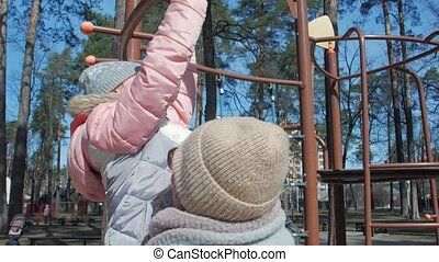 Girl With Mother On The Playground