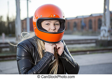 Girl With Motorcycle Helmet - Cute girl with blond hair with...