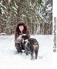 Girl with mountain dog