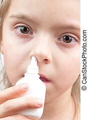 girl with nose spray