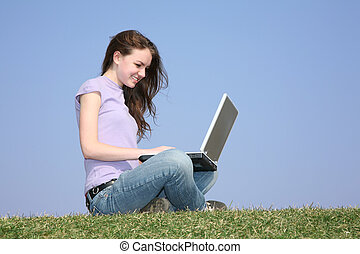 girl with notebook on meadow