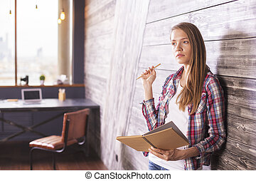 Girl with notepad in hands