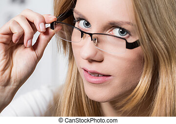 Girl with optical glasses