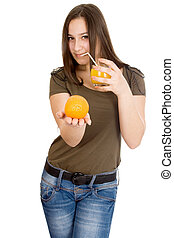 Girl with orange juice and orange in his hand