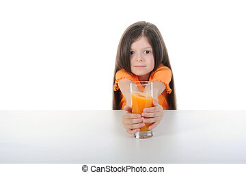 Girl with orange juice at the table