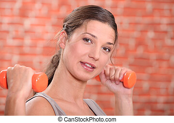 Girl with orange weights