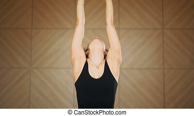 Girl with oriental appearance doing stretching, breathing...