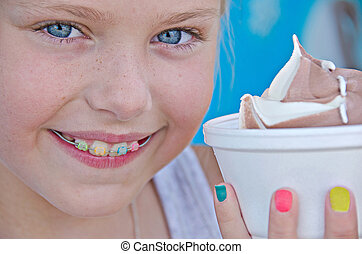 girl with orthodontic smile - Young Caucasian girl with an...