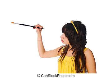 Girl with paintbrush on white background