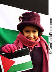 A little beautiful girl holding palestinian flag in front on another one