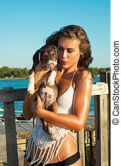 girl with pappy dog on summer vacation at sea