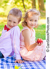 Girl with peach and a little gentleman at the picnic