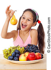 Girl with pear and plate of fruit