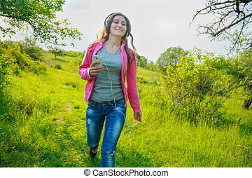 girl with phone and headphones