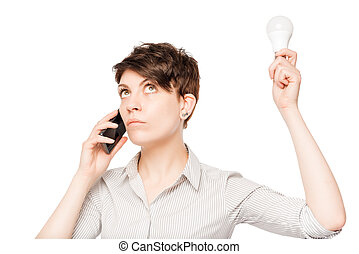 girl with phone and lamp in the hands posing on a white background