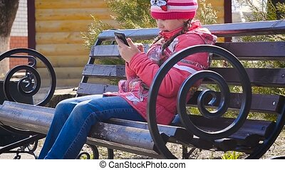 Girl with phone in park