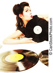 Happy girl retro woman with vintage phonography analogue vinyl records music lover