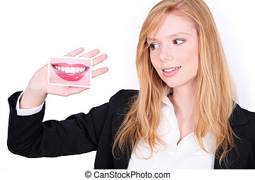 girl with picture of a mouth in hand