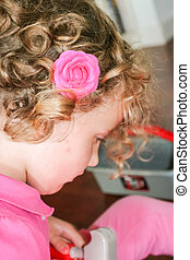 Girl with pink rose