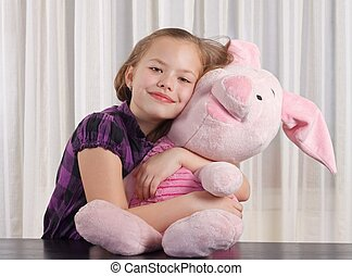 Portrait of a young girl holding a plush toy